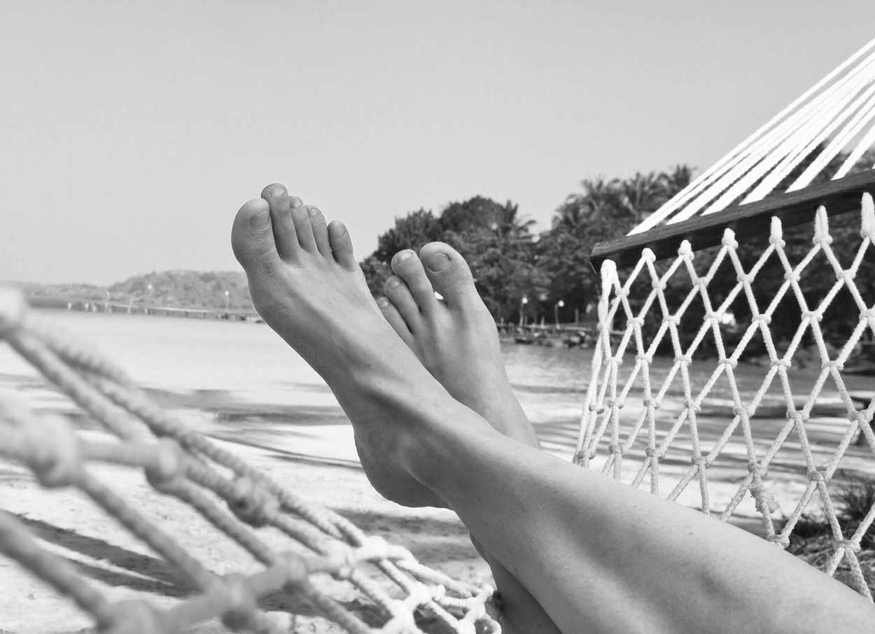 feet resting in hammock