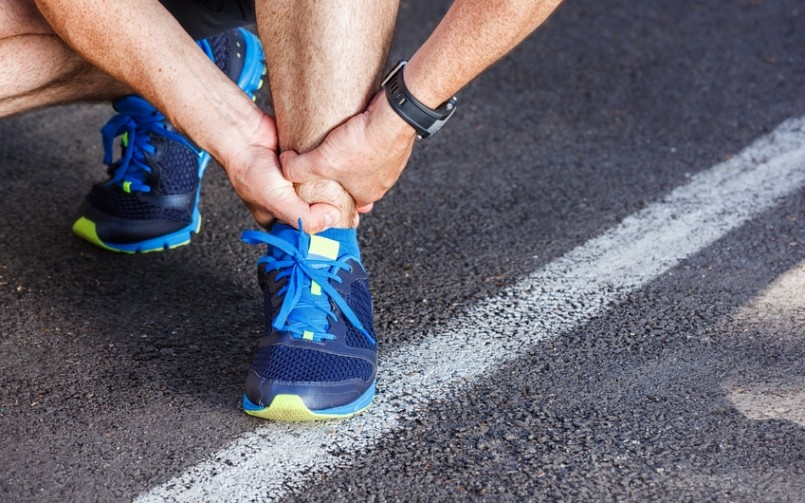 Man with running sport injury Achilles tendonitis